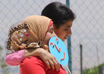 2 refugees walking